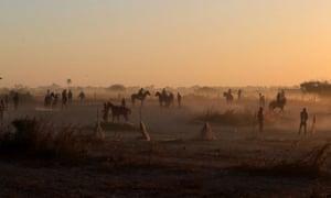 Jockeys arrive for an early morning training session in Sangalkam