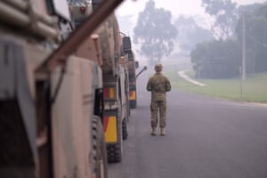 The Princes Highway has been cut by bushfires, with convoys escorted by military vehicles the only traffic on the vital road.