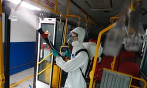 A military officer disinfects a special bus for quarantine passengers at a fire station, where buses and taxis that carried quarantined persons are spread with disinfectant, following a surge of domestic Covid-19 cases in Taiwan.