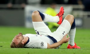 Harry Kane lies on the turf at Wembley.