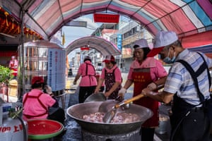 Taichung, TaiwanPeople cook in front of a water station in their neighbourhood during a water ration