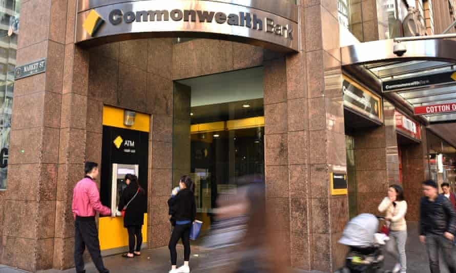 People walk past a Commonwealth Bank branch