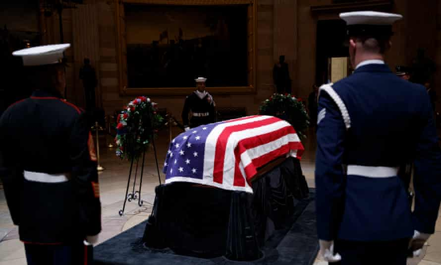 Former president George HW Bush lies in state in the Rotunda of the US Capitol in Washington DC.