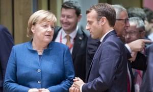 Angela Merkel and Emmanuel Macron.