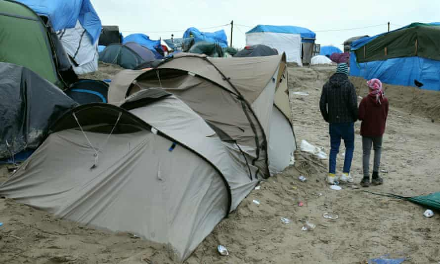 Refugee children walking among the tents at the camp.