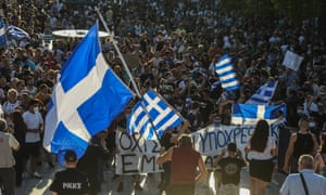 Anti-vaccine protesters take part in a rally on 14 July in front of the Greek parliament in Athens after the government announced mandatory Covid-19 vaccinations for all health workers.