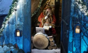 A man dressed as Father Christmas learns how to use Zoom on a laptop in the grotto at Bamburgh castle in Northumberland.It was due to open on 21 November but due to the new national lockdown in England he will now be speaking to the children via video.