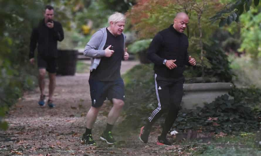 Boris Johnson running in August, four months after he contracted Covid-19, with his personal trainer and bodyguard.