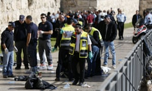 Officials inspect the scene of the attack outside Jerusalem's Jaffa gate