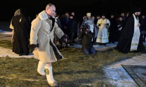 Putin walks to the icy waters of Lake Seliger.