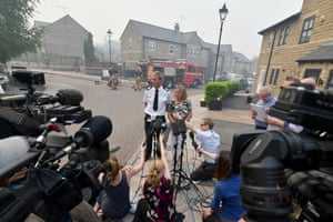 David Keelan from Greater Manchester Fire and Rescue speaks to media on Calico Close