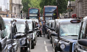 Black cab and licensed taxi drivers protest the introduction of Uber in London, June 2014.