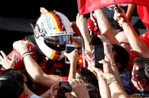 Ferrari's Sebastian Vettel celebrates his win after the race.