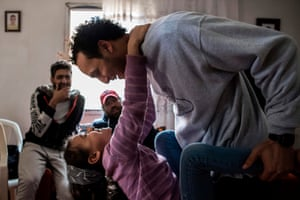 Cairo, Egypt: Mahmoud Abu Zeid plays with his niece at his home after his release from prison