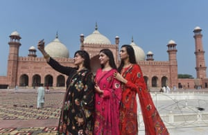 Lahore, Pakistan: Women take a selfie after offering Eid al-Adha prayers at the Badshahi mosque