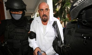 Serge Atlaoui is taken by armed police officers to his judicial review hearing at the district court in Tangerang, Indonesia, in March 2015.