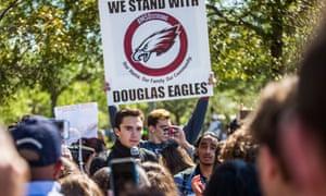 David Hogg, a shooting survivor, speaks during the school's walkout.