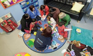Parents and their children at Sure Start Whitley in Reading.