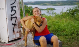Rachelle Bergeron with one of the couple's dogs, Nubs, in Yap. Nubs was not the dog that was killed in the shooting.