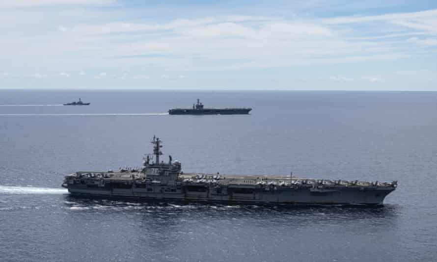 US Navy ships sailing through the South China Sea in July this year as part of freedom of navigation exercises.