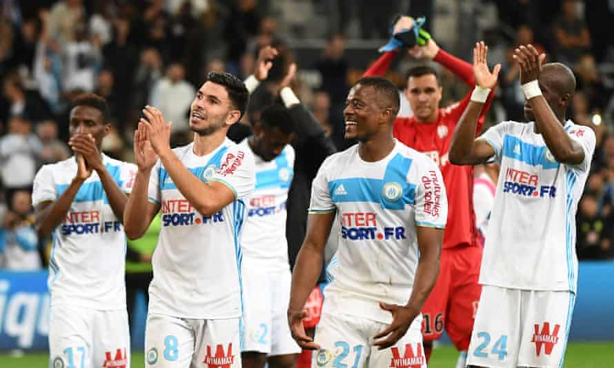 The Marseille players, including Patrice Evra, third from right, celebrate after coming from behind to beat Nice 3-2.