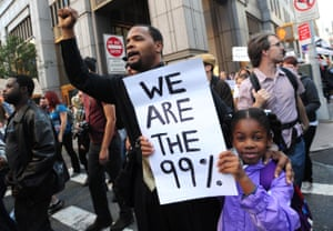 Protesters with 'We are the 99%' placard during Occupy Wall Street.