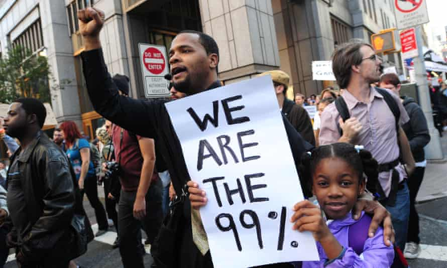 Protesters with 'We are the 99%' placard at the Occupy Wall Street protests, New York, October 2011.