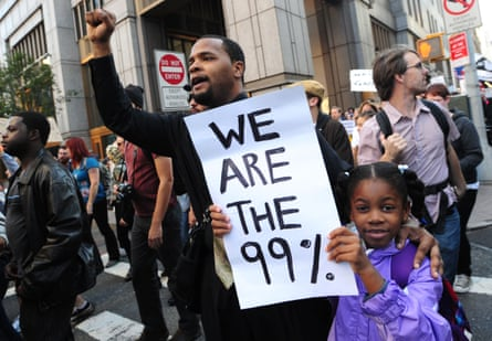 Protesters with 'We are the 99%' placard