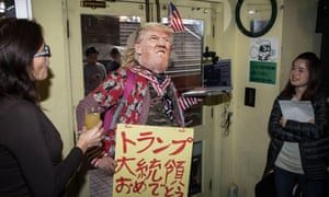 Reaction to the US presidential election results in a bar in Tokyo.