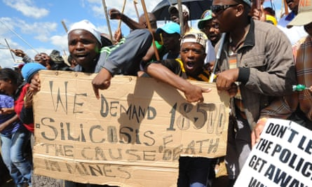 Striking miners demand compensation as they march to the offices of AngloGold Ashanti in the gold-mining town of Carletonville in October 2012