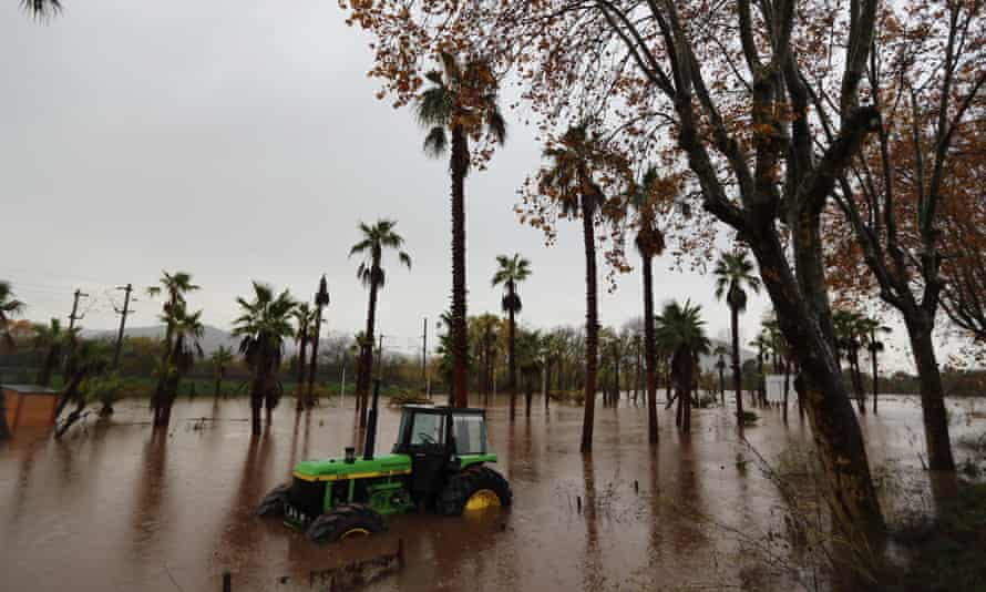 A tractor in a flooded area after heavy rain in Roquebrune-sur-Argens, France.