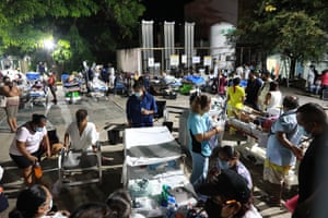 Doctors and patients outside a hospital after being evacuated following a 7.0 magnitude earthquake in Acapulco, Mexico