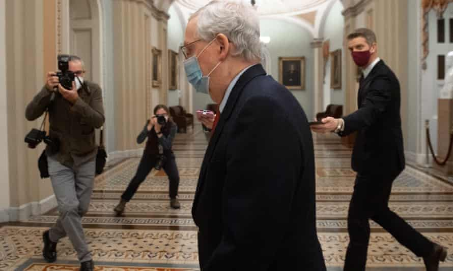US Senate majority leader Mitch McConnell walks to the Senate floor at the US Capitol on 18 December.