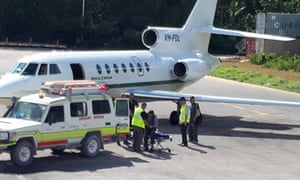 The Afghan refugee known as Ali being transferred to an aircraft on Nauru on Saturday.