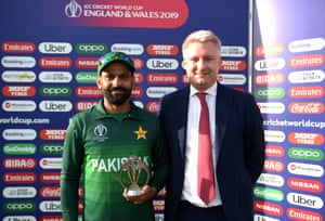 Mohammad Hafeez of Pakistan holds his award after being named Man of the match.