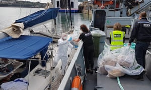 National Crime Agency officers seize the drugs from the yacht at Fishguard port in Pembrokeshire.