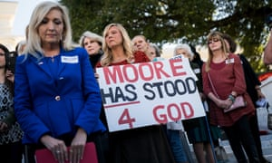 Alabama residents attend a 'Women For Moore' rally in Montgomery. Kayla Moore told the crowd of supporters that her husband will not bow out of the Senate race.