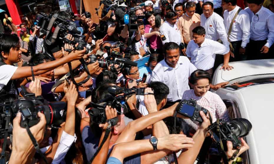 Aung San Suu Kyi being photographed