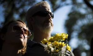 Paul Finch, right, holds a bouquet of flowers with Melanie Crolley during the remembrance march