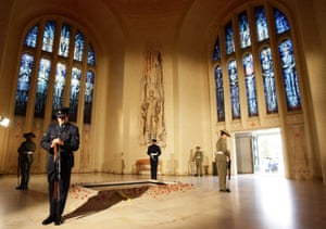 Servicemen stand guard around the tomb of the unknown soldier in Canberra on Anzac Day in 2009.