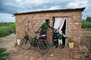 Anick Lubinda at home in Mukwalantila village. with her bike.