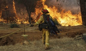 A wildfire advances on to a residential district in Redding, California.