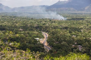 A forest fire burns near a road running through the forests of central Sri Lanka