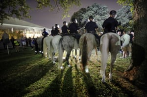 Police on horseback begin to move in and push protesters from Pioneer Park following a rally against white supremacists at Dallas City Hall