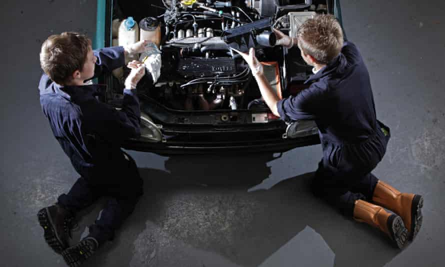 BTec students work on a car engine