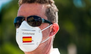 A taxi driver in Malaga wearing a face mask with a Spanish flag amid the coronavirus outbreak