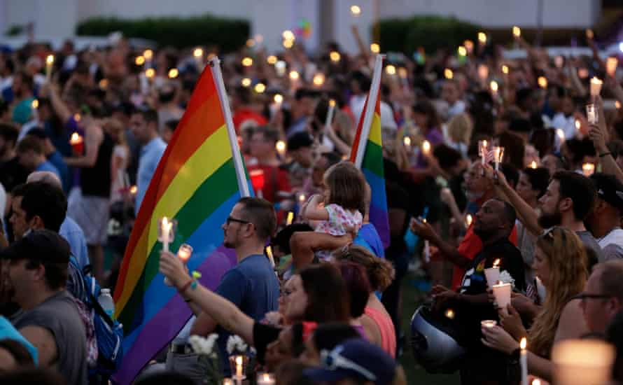 Supporters of the victims of the recent mass shooting at the Pulse nightclub attend a vigil at Lake Eola Park.