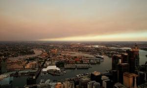 Smoke haze hangs over Sydney on Tuesday morning as bushfires burn across New South Wales.