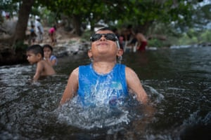 Veracruz, Mexico: local children and their families take advantage of the lack of tourists in their town to enjoy the waters of the River, closed to prevent the spread of coronavirus
