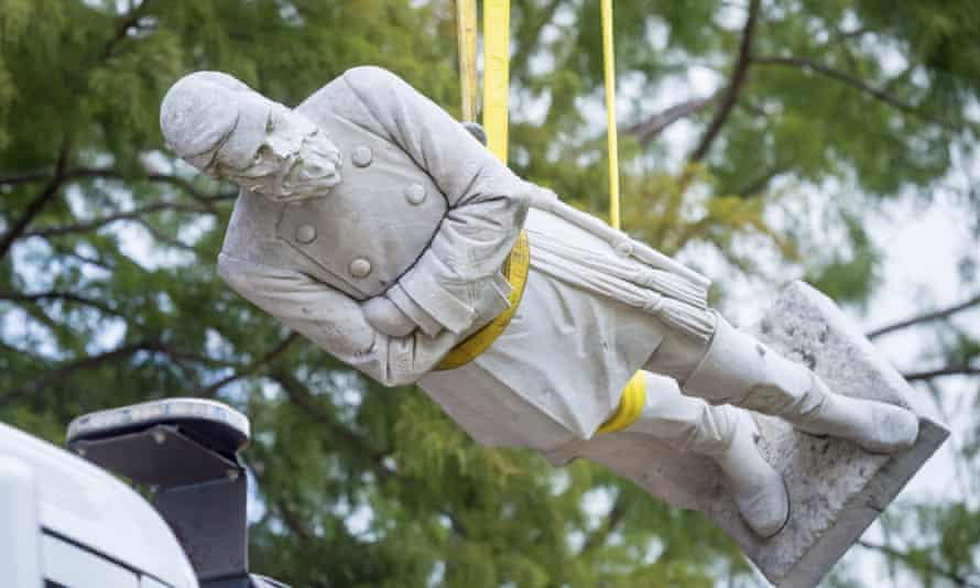 The statue of Confederate Gen Alfred Mouton is removed on Saturday, in Lafayette, Louisiana.